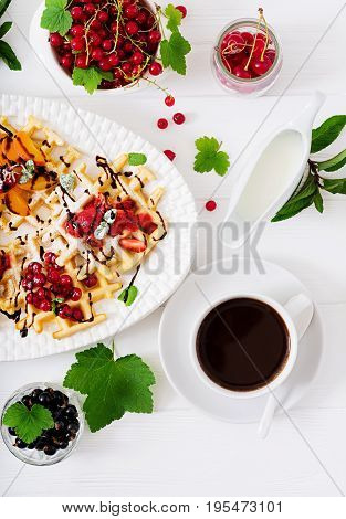 Variety Of Belgian Wafers With Berries, Chocolate And Syrup.