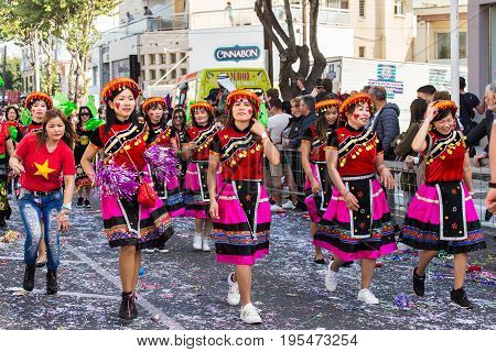 LIMASSOL, CYPRUS - FEBRUARY 26: Carnivalists in a silver cylinder hats joyfully follow the Limassol Municipality Band during the annual Carnival Parade, February 26, 2017 in Limassol.