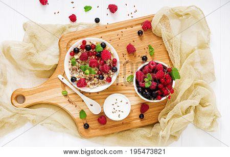 Tasty And Healthy Oatmeal Porridge With Berry, Flax Seeds And Yogurt. Healthy Breakfast. Fitness Foo