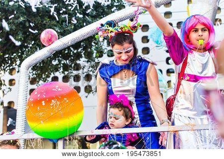 LIMASSOL, CYPRUS - FEBRUARY 26: Happy people in teams dressed with colorfull costumes at famous, February 26, 2017 in Limassol.