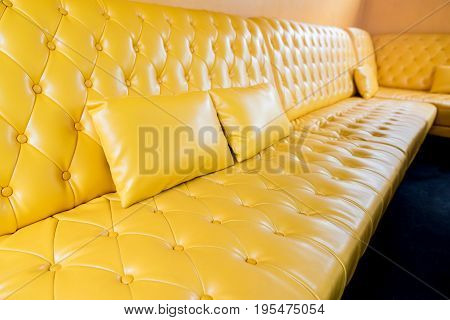 Yellow sofa and pillow in the living room