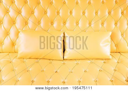 Yellow sofa and pillow in the living room copy space.