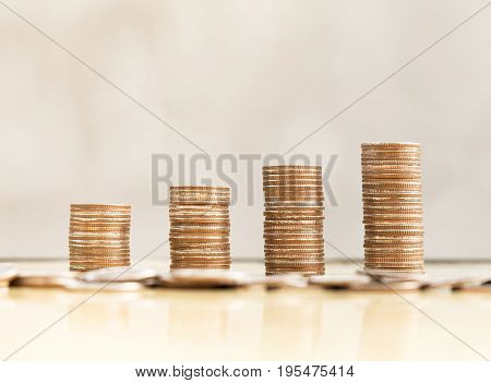 step of coins stacks money saving and investment or family planning concept.