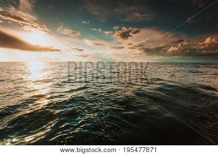 Beautiful seascape evening Baltic sea sunset horizon and cloudy sky. Tranquil landscape scene.