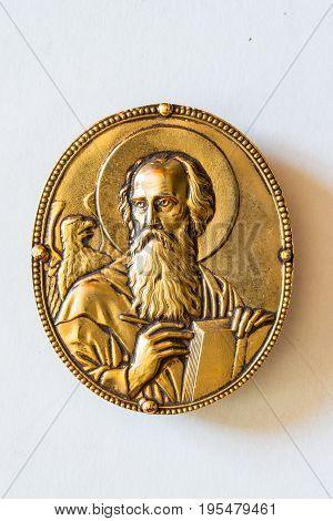 Vintage rounded filigree golden evangelist symbol for gospel book