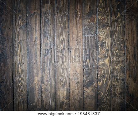 Old, shabby and vitage floor. Wooden brown planks texture.