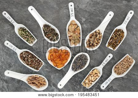 Herb selection with melatonin capsules used in natural herbal medicine to heal anxiety and sleeping disorders.