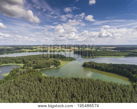 Aerial View Of Green Islands And Clouds At Summer Sunny Morning. Masurian Lake District  In Poland.