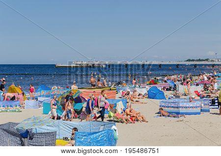 KOLOBRZEG, WEST POMERANIAN / POLAND: Tourists are resting on a sunny beach