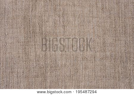 Brown sackcloth rough rustic fabric texture .