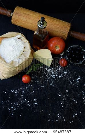 Composition Of Bag Of Wheat Flour, Oil, Tomato, Cheese And Rolling Pin. Preparation For Kneading Dou