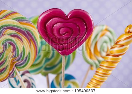 Glass jars in Colorful candies,lollipops and gum balls