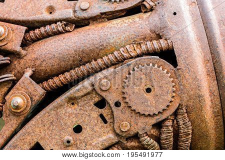 Rusty Industrial Cogwheel And Other Scratched Parts Of Old Machine