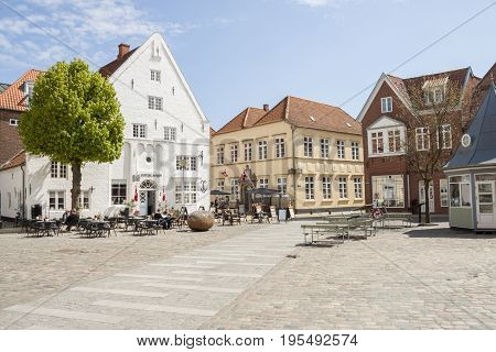 TONDER DENMARK - MAY 7 2017: People relaxing on sunny sunday in restaurant on main square of old town on may 7 2017 in Tonder Denmark.