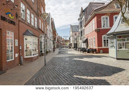 TONDER DENMARK - MAY 7 2017: People on main street of old town on sunny sunday on may 7 2017 in Tonder Denmark.