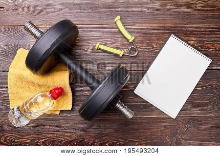 Sport equipment, notebook with copy space. Get fit and note sport results.
