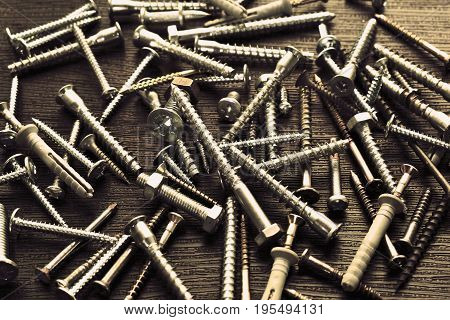 Composition for the background. Screws, bolts, nails. Tool.
