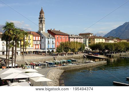 Ascona, Switzerland - 19 October 2014: Tourists walking and sitting on restaurants on the waterfront of Ascona on Switzerland