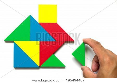 Colorful tangram puzzle in home shape wait for fulfillment (Concept for complete or dream life)