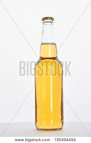 Bottle of lager isolated on white background. Full bottle of cold alcohol drink.