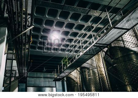 Metal Ceiling And Tanks In A Row