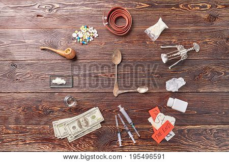 Still life of narcotic preparations. Image of clock from drugs.