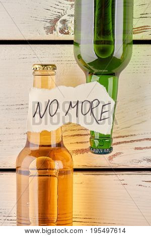 Live full life without alcohol. Recovery after alcoholism. Bottles on wooden background.