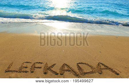 Lefkada written on sandy beach in Greece