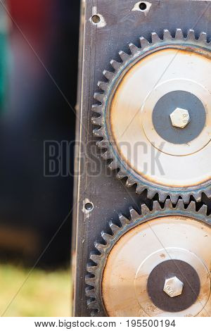 Sprocket gear made of steel close up. Industrial machinery objects details concept.