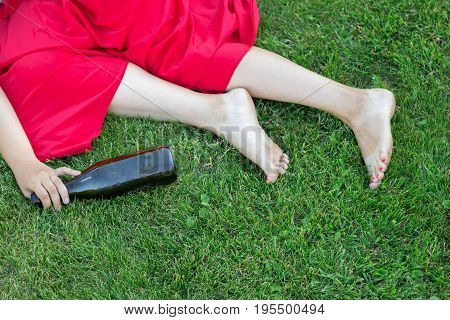 Drunk Girl Sleeping In The Park After The Party. The Problem Of Female Alcoholism.