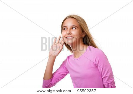 Picture of beautiful young girl listening gossip.White background with copyspace