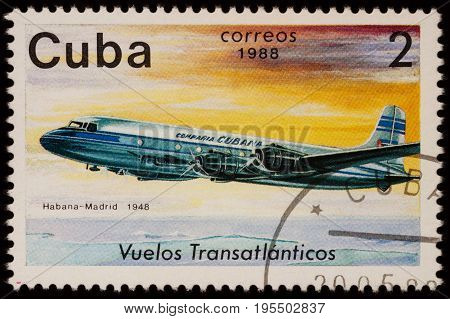 Moscow Russia - July 14 2017: A stamp printed in Cuba shows passenger airliner Douglas DC-4 Airline Havana-Madrid (1948) series