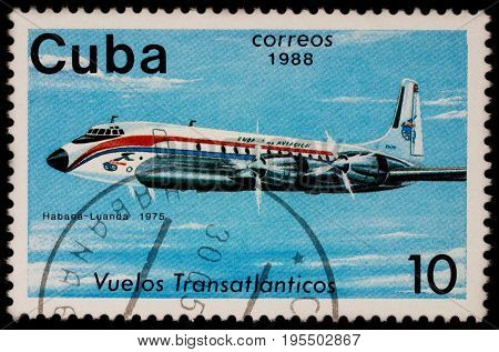 Moscow Russia - July 14 2017: A stamp printed in Cuba shows passenger airliner Douglas DC-7 Airline Havana-Luanda (1975) series