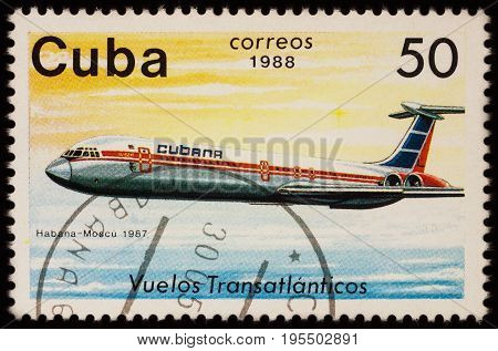 Moscow Russia - July 14 2017: A stamp printed in Cuba shows passenger airliner Ilyushin IL-62 Airline Havana-Moscow (1987) series