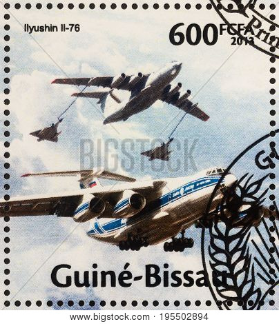 Moscow Russia - July 15 2017: A stamp printed in Guinea-Bissau shows Ilyushin Il-76 Candid - heavy multi-purpose four-engine turbofan strategic airlifter series