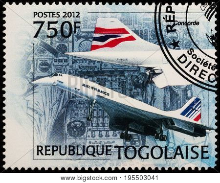 Moscow Russia - July 14 2017: A stamp printed in Togo shows Henri Perrier and supersonic airliner Concorde series