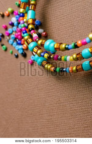 costume jewellery artistically scattered on brown background