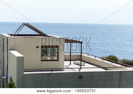 Additional spacy room on top of a house with a solar panel
