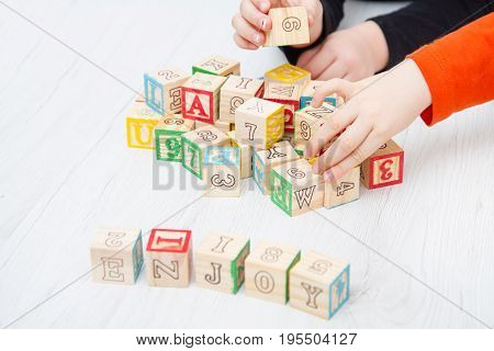 the enjoy written on wooden cubes on wood