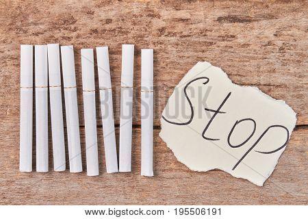 White cigarettes, message stop close up. Stop smoking cigarettes concept.