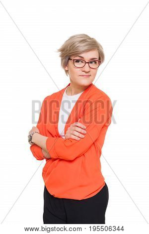Blond stylish shy woman in eyeglasses. Young fashionable businesswoman in casual clothes. Beautiful attractive female portrait isolated at white background.