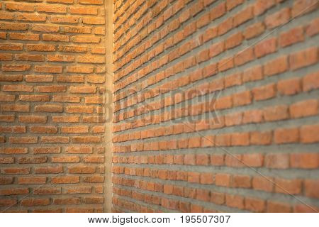 Background of old vintage brick wall/Background of brick wall texture/Vintage red brick wall/corner of old dirty interior with brick wall/The corner of a brick wall/Close up of brick wall