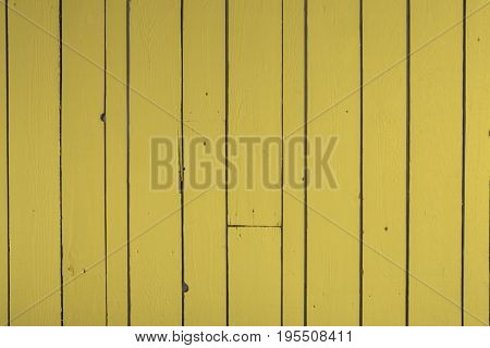 Yellow reclaimed timber wall backgound