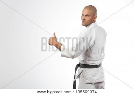 Fighter In White Kimono Posing On Isolated