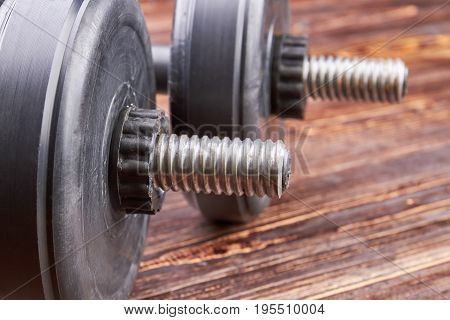 Close up of two metal dumbbells. Heavy object for fitness in gym.