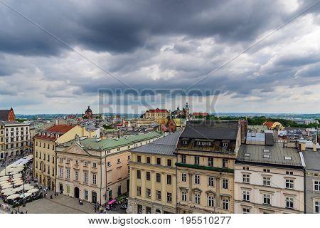 Krakow - Wawel castle with dramatic sky in urban areas. Poland Europe.