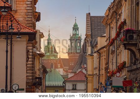Krakow - Wawel castle in sunset time in urban areas. Poland Europe.