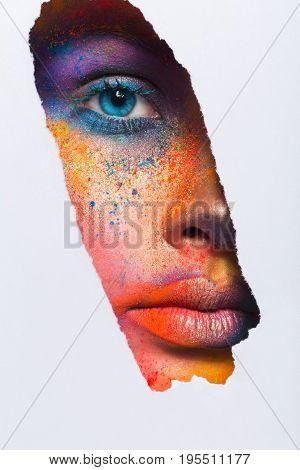 Fashion creative art of makeup. Abstract colourful splash make-up. Holi festival