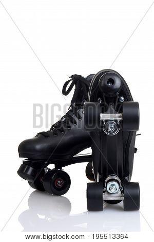bottom of mens quad roller skates on white background