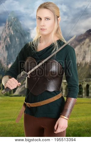 female wood elf with a sword and mountains in background